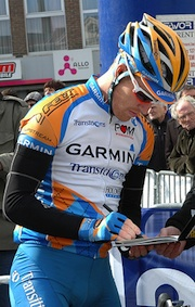 Tyler Farrar signs into a race
